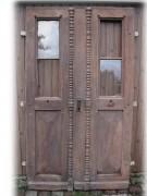 Ladentüre, Geschäftshaustüre, zweiflügelig mit Schutzklappe aus Eisen