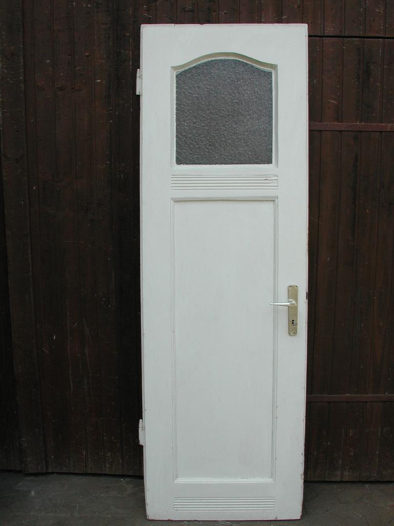 Historische Zimmertüre mit original Verglasung und geschwungenem Fries